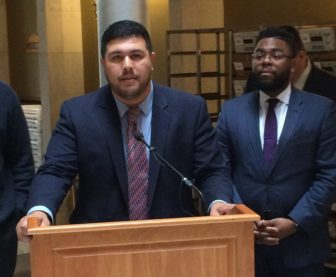 This is a picture of Rep. Christopher Rosario, D-Bridgeport (left) and Rep. Brandon McGee, D-Hartford, address reporters