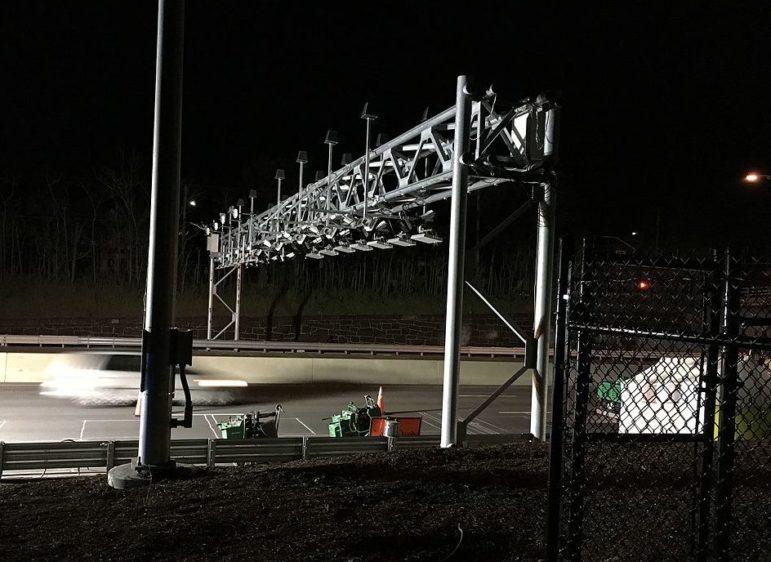 Modern tolls use overhead gantries like this one on the Massachusetts Turnpike (Arnold Reinhold / Creative Commons)
