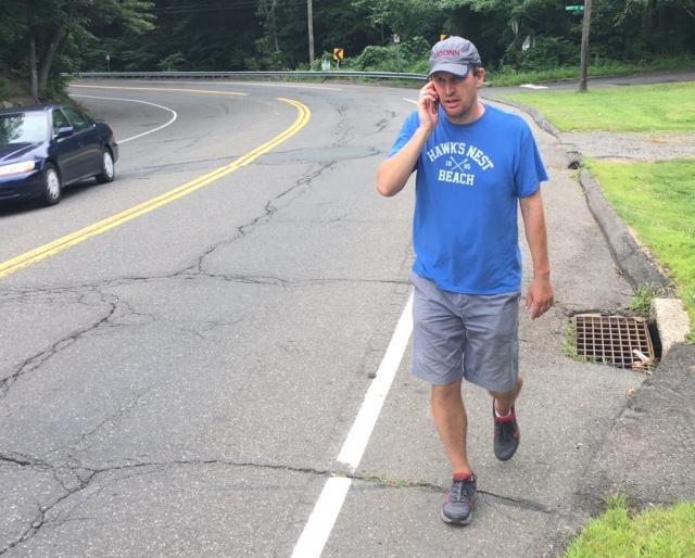 In first TV ads, Chris Murphy walks the walk