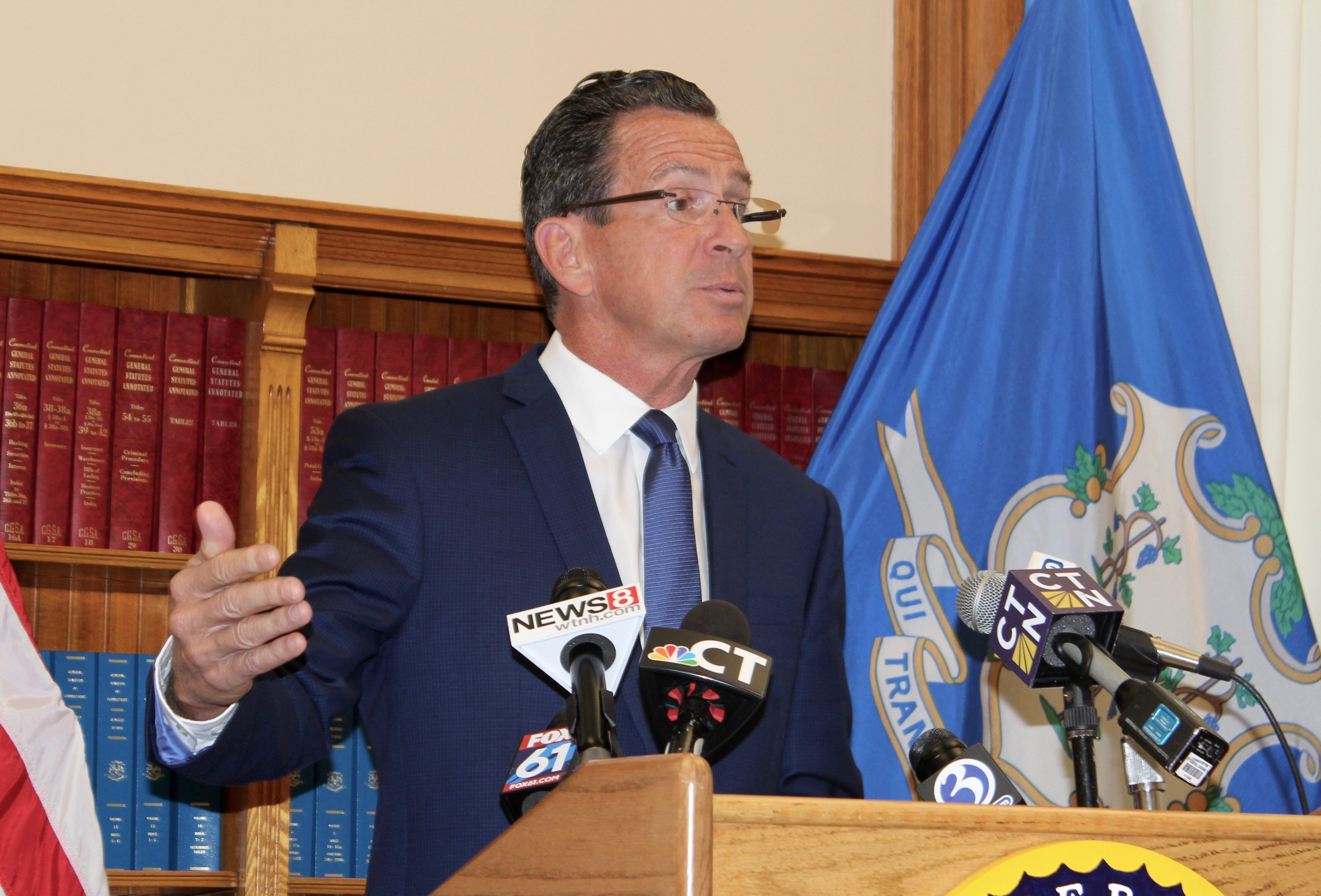 Malloy defends his track record on aiding cities and towns
