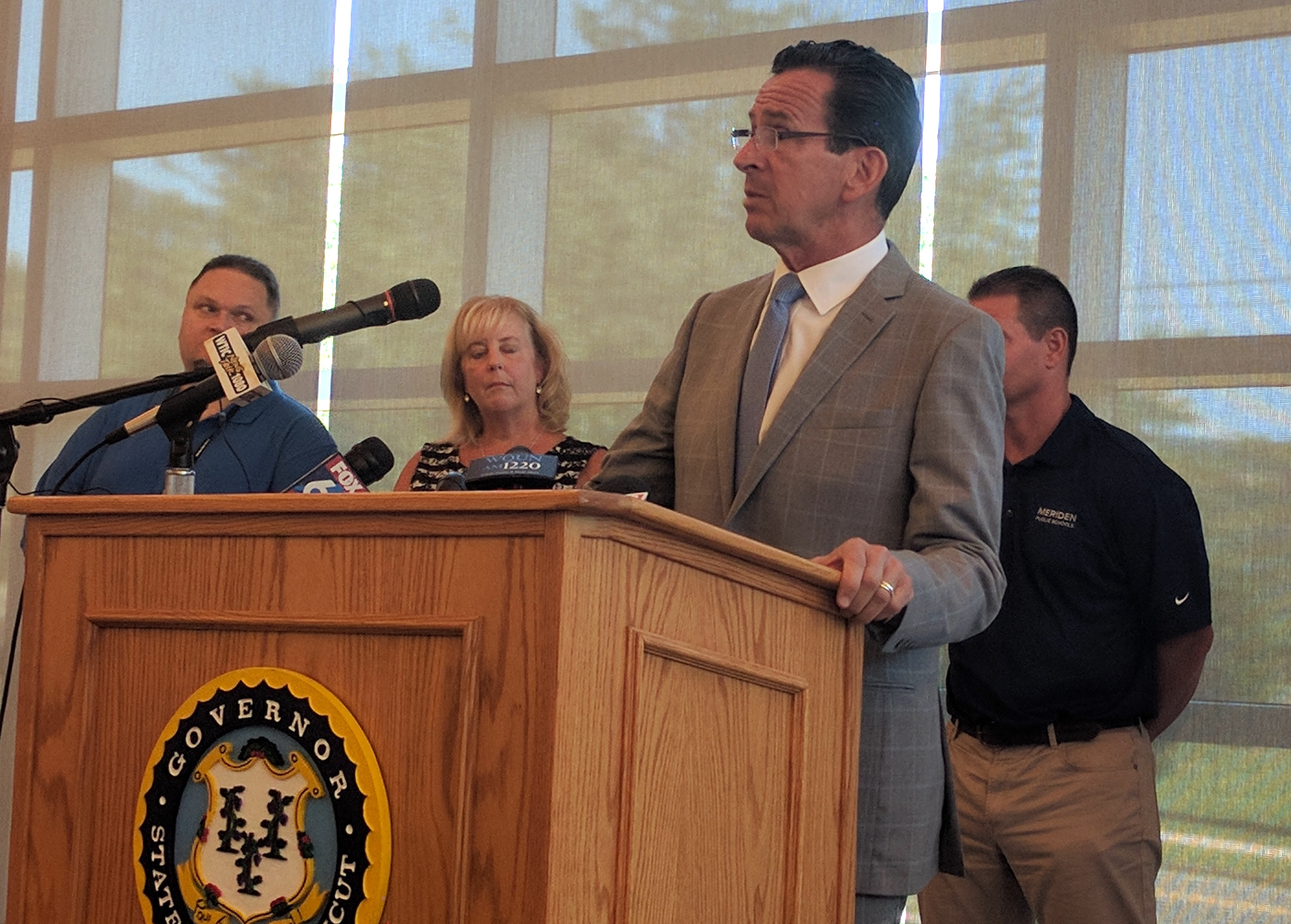 Without a budget, Malloy says he will shift state aid to poorer school districts