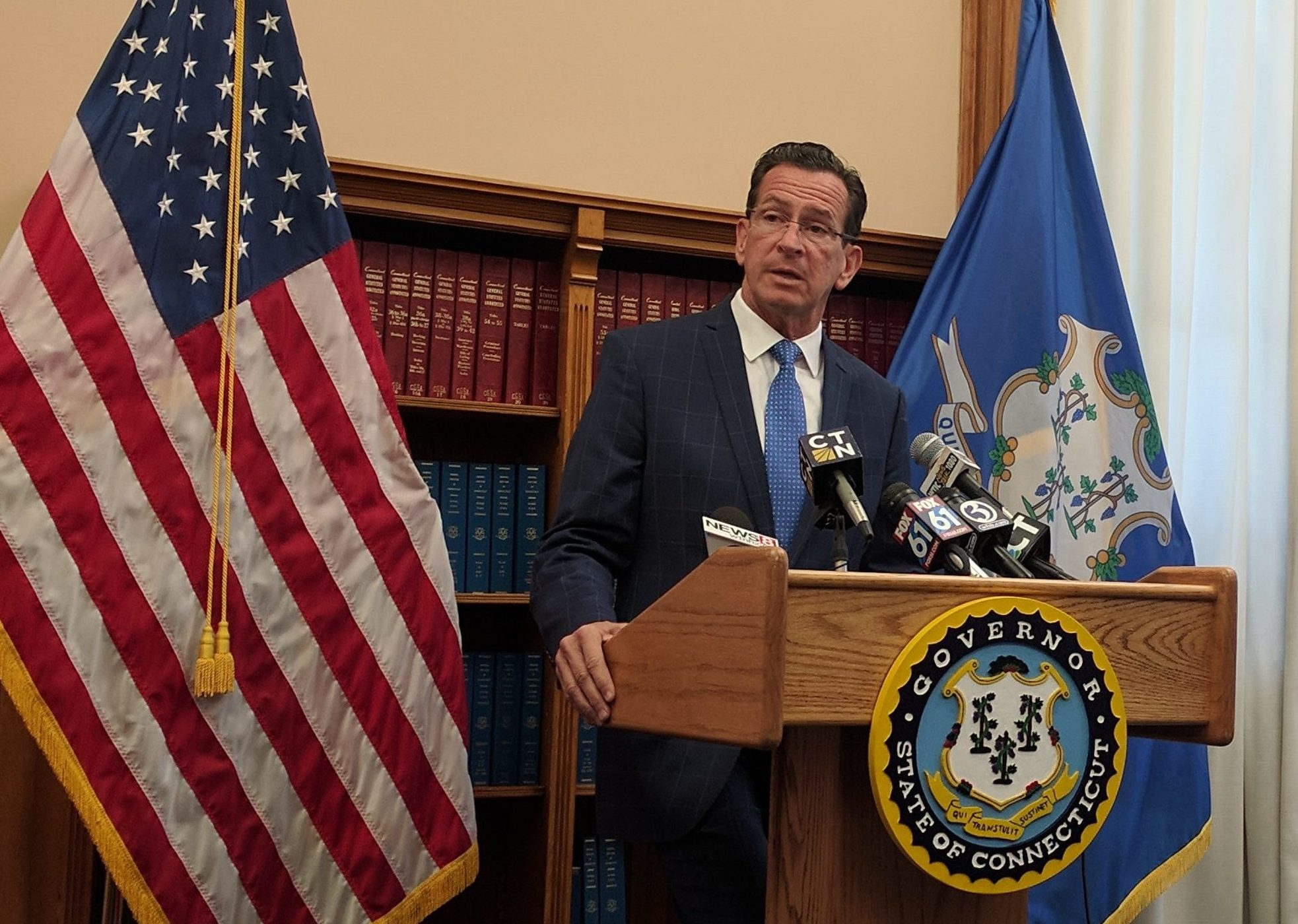 Malloy would accept sales, hospital tax hikes to restore town aid