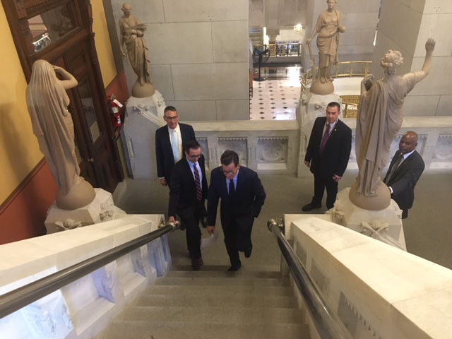 Shut out of budget talks, Malloy takes a stroll — to visit the press