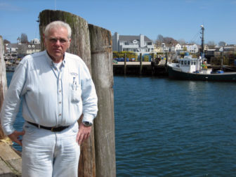 Mike Gambardella outside his wholesale operation in Stonington. In the past, the docks would be bustling from early in the morning until after midnight.