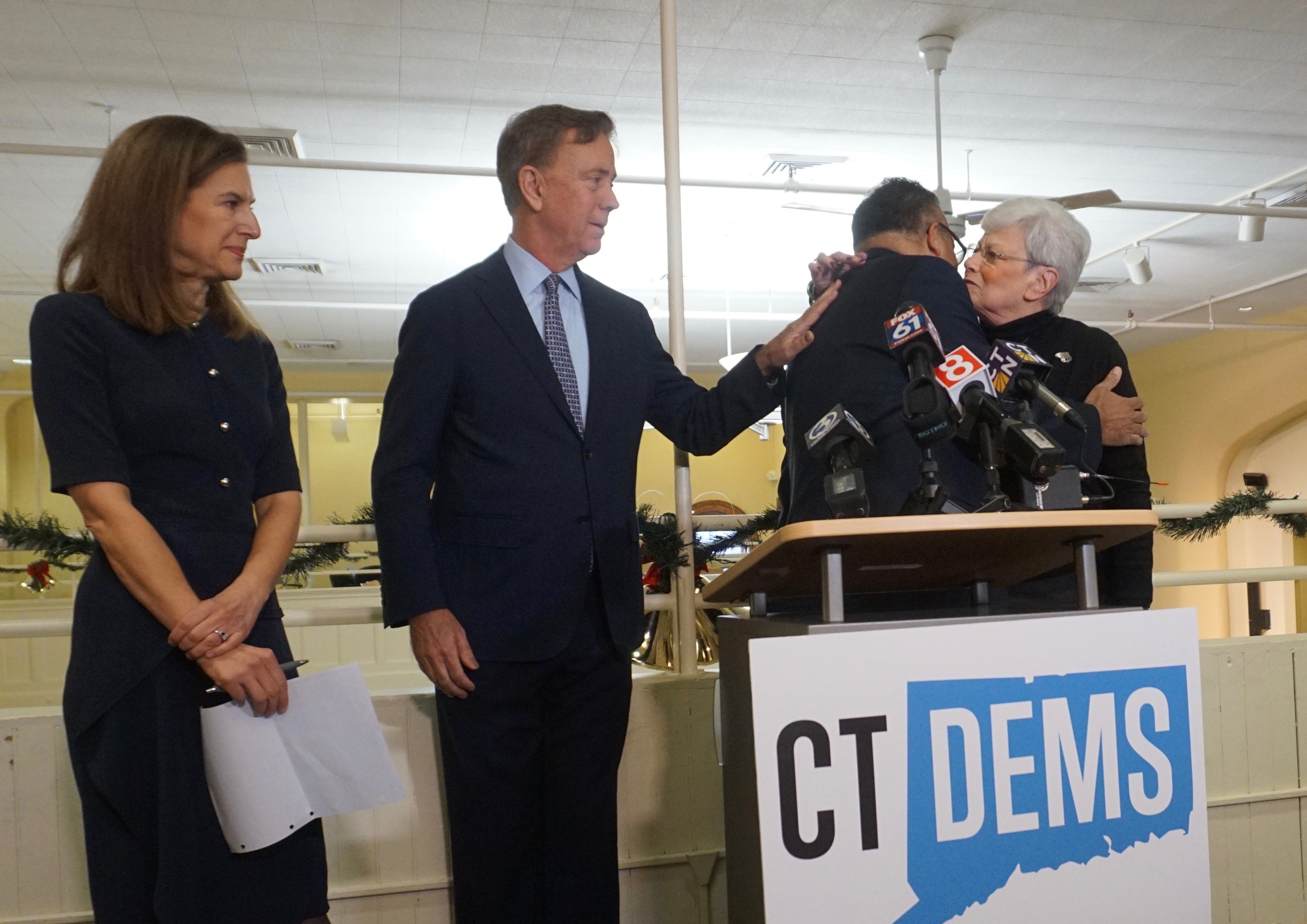 A kiss, some kind words — and a dismissal of a Democratic chair