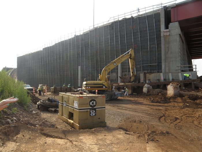 Work at the old Q-Bridge foundation, prior to construction of a retaining wall that would support traffic from I-95 Southbound to I-91 Northbound. (Image courtesy of the State Department of Transportation)