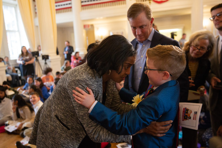 Ella is congratulated by U.S. Rep. Jahana Hayes, a former National Teacher of the Year, as Gov. Ned Lamont looks on.
