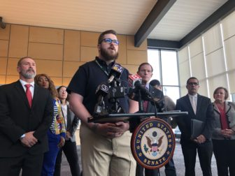 Christopher Scofield, a technician at Bradley International Airport, speaks at the press conference on Monday.