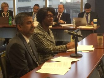 The State Department of Education's Ajit Gopalakrishnan and Charlene Russell-Tucker present the state's report on suspensions and expulsion Wednesday.