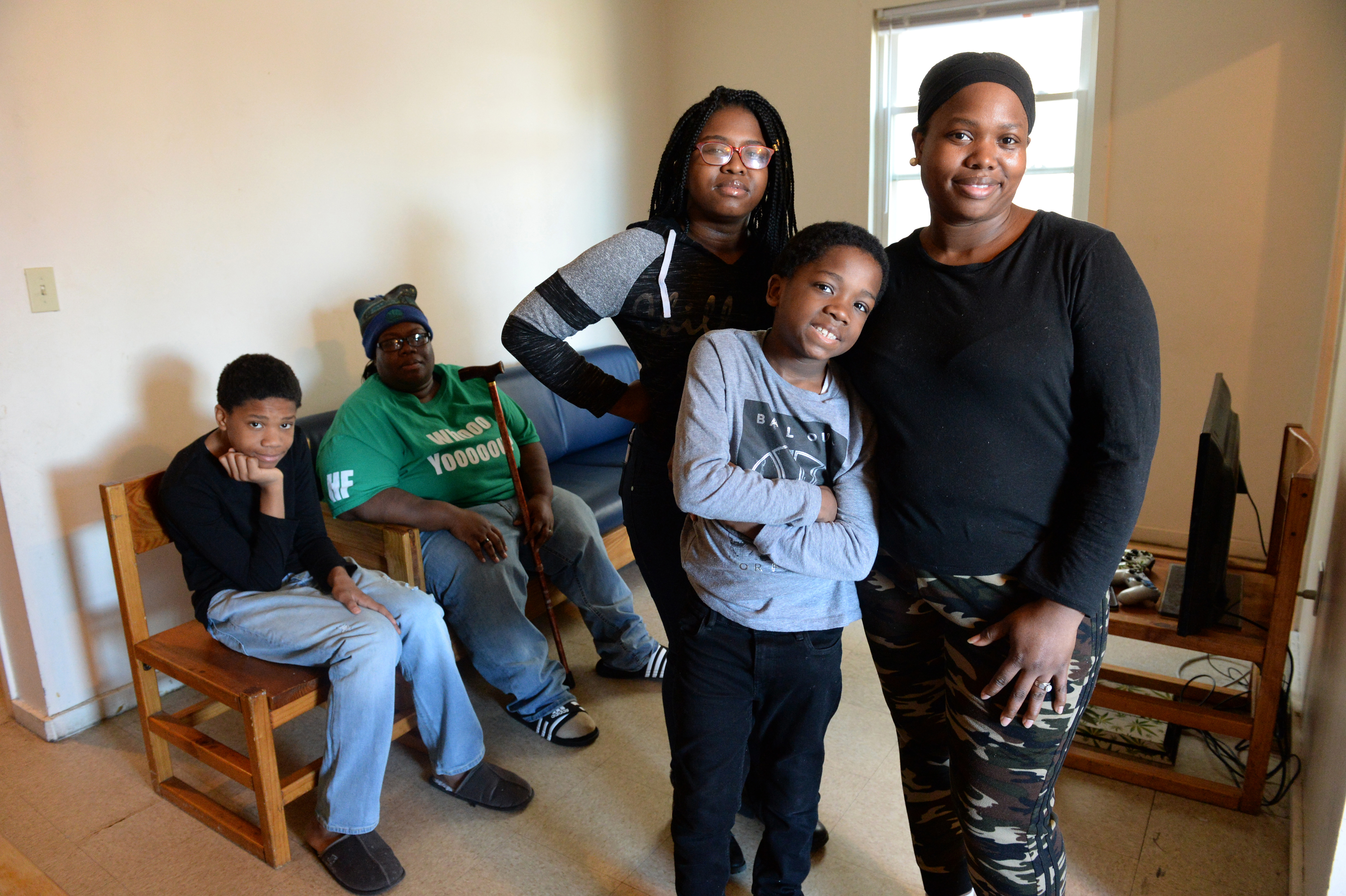 Ashana Cunningham lives with her wife, India Cunningham and her three children - Ansoneya Mitchener, 15, Robert Hallums, 12 and Brandon Mitchener, 9 - in a three-bedroom apartment in a Bridgeport shelter. Cunningham fell on hard times after being injured in a car accident that totaled her car. She had to quit her job after a two week hospital stay and now works part-time at a day care center for $12.50 per hour. Cunningham is looking for a better paying job and affordable housing for her family.