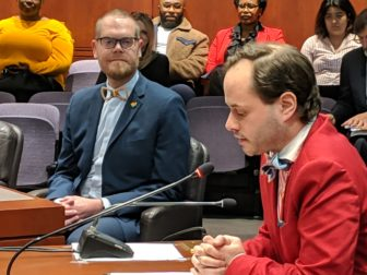 Patrick J. Dunn, executive director of the New Haven Pride Center, speaks up in favor of a bill that would establish a health and human services network for the LGBTQ community. Rep. Jeff Currey, at left, co-introduced the bill.