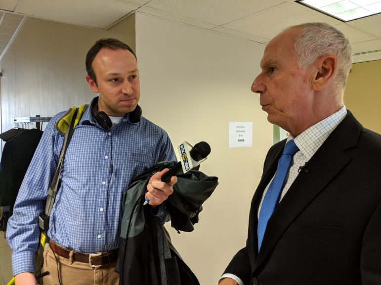 CSCU President Mark Ojakian talked to reporters, including WTIC reporter, Aaron Kupec, following vote to raise tuition at state universities by 5 percent.
