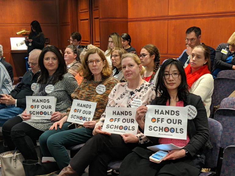 Opponents to the governor's Bill No. 874, which promotes the sharing of school services, turned out for Education Committee meeting.