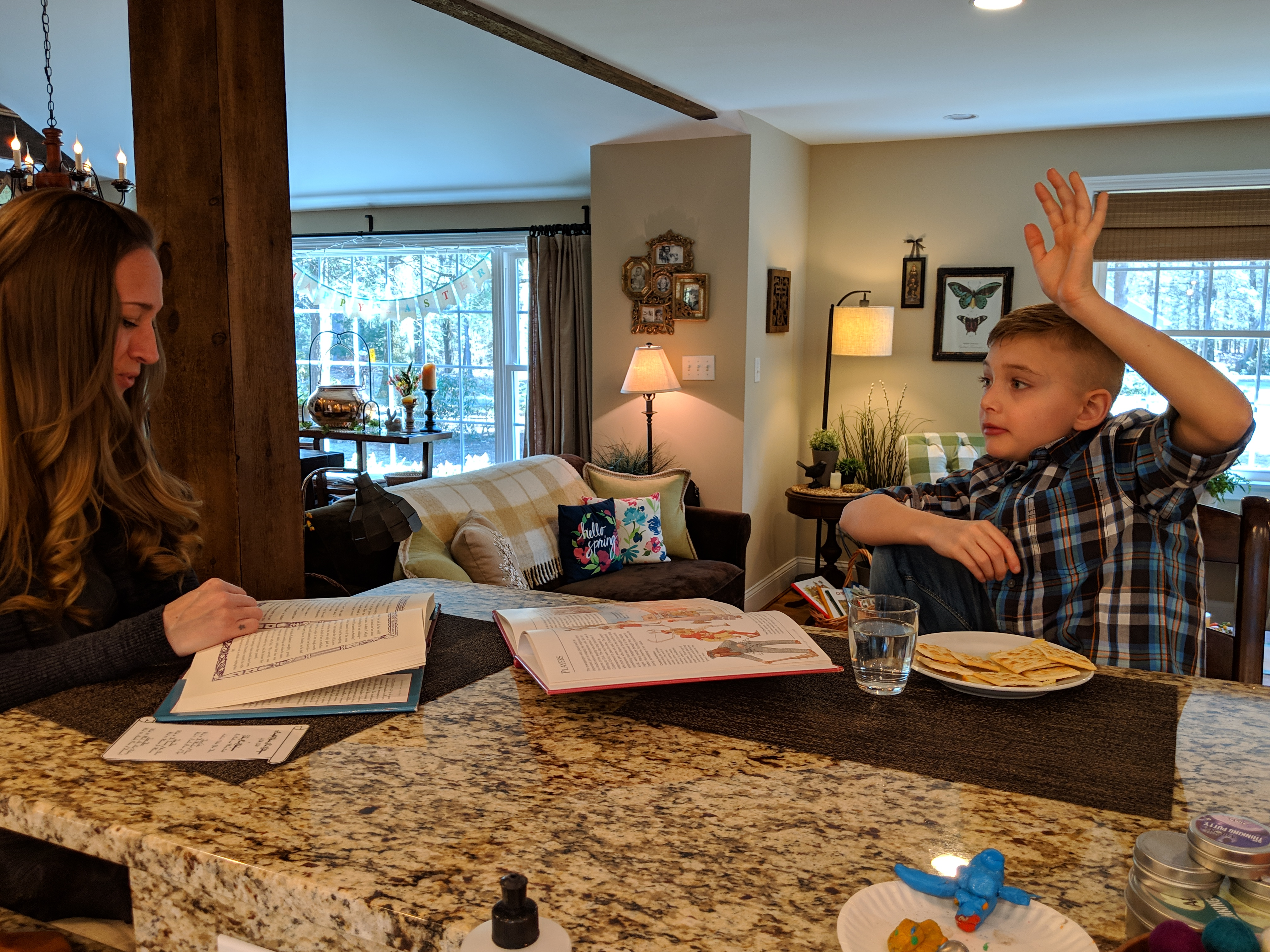 "Tucker Schlotter has a question for his mother, Lina, as she reads to him from Shakespeare's ""Taming of the Shrew"" during a homeschooling lesson recently."