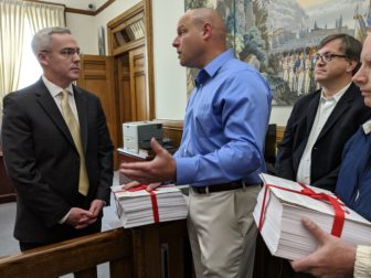 Patrick Sasser, founder and leader of No Tolls CT delivered petitions with more than 100,000 signatures to the governor's office on Thursday. Chief of Staff Ryan Drajewicz received them and met with Sasser for a conversation.