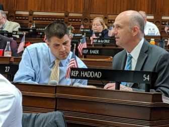 Rep. Gregg Haddad, right, co-chairman of the higher education committee, confers with his vice-chair, Rep. Gary Turco, in House on Monday.