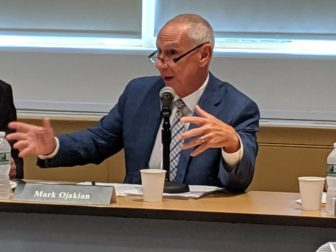 Mark Ojakian, president of the Connecticut State Colleges and Universities system, explains budget details to the board at Thursday's meeting.