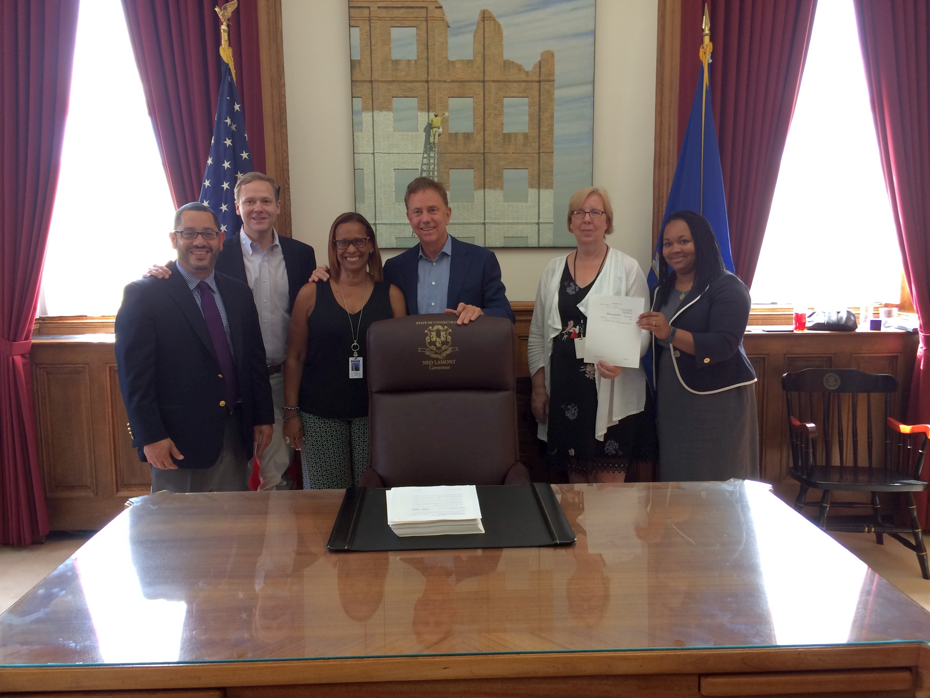 Lamont signs new budget, says it will bring stability to CT