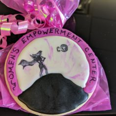 Karen Delgado, who started a new baking business with help from the CRT's Women's Empowerment Center, created this cookie to celebrate the formal opening of the center.
