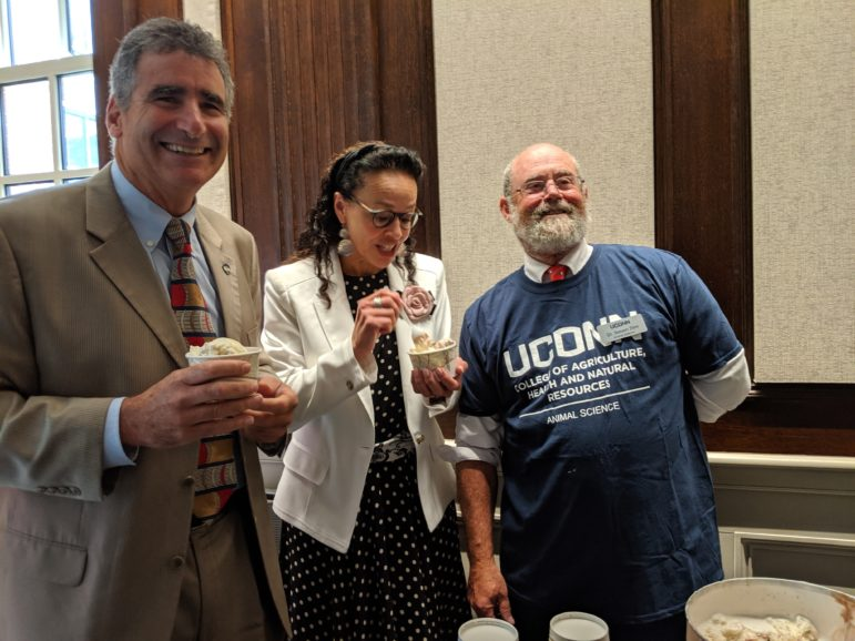 During a break in Wednesday's trustee meeting, UConn's new president, Tom Katsouleas, left, enjoys lemon icebox ice cream from the UConn Dairy with UConn board member, Marilda L. Gandara and Prof. Steven A. Zinn, head of Animal Science Department. Katsouleas and the trustees were treated to the ice cream which was recently named the best from a university by the American Society of Animal Science.