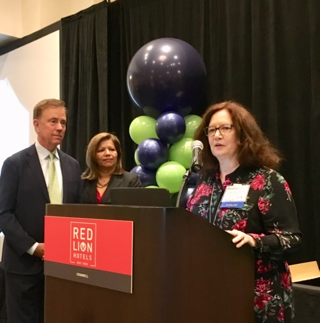 Lamont brings greetings, not cash, to housing conference