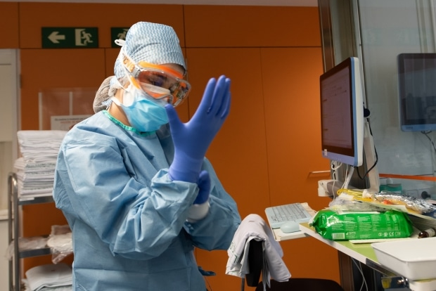 Rationing protective gear means checking on coronavirus patients less often. This can be deadly.