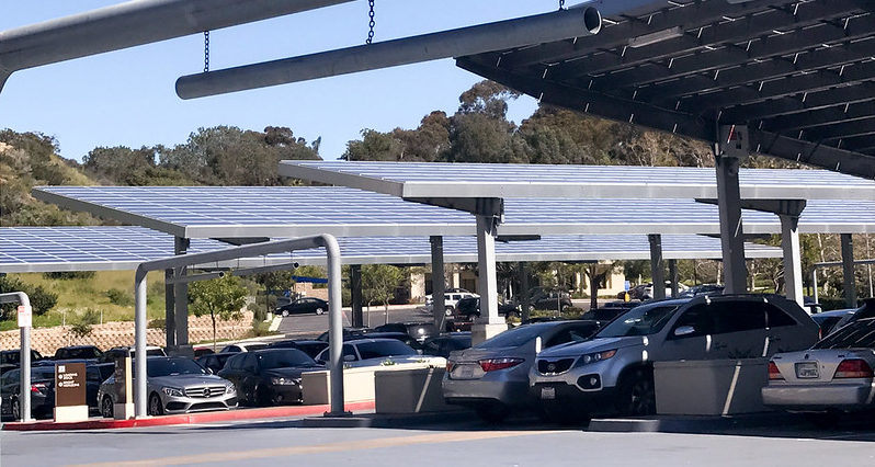 Save farmland, gain solar energy, with panels over parking lots