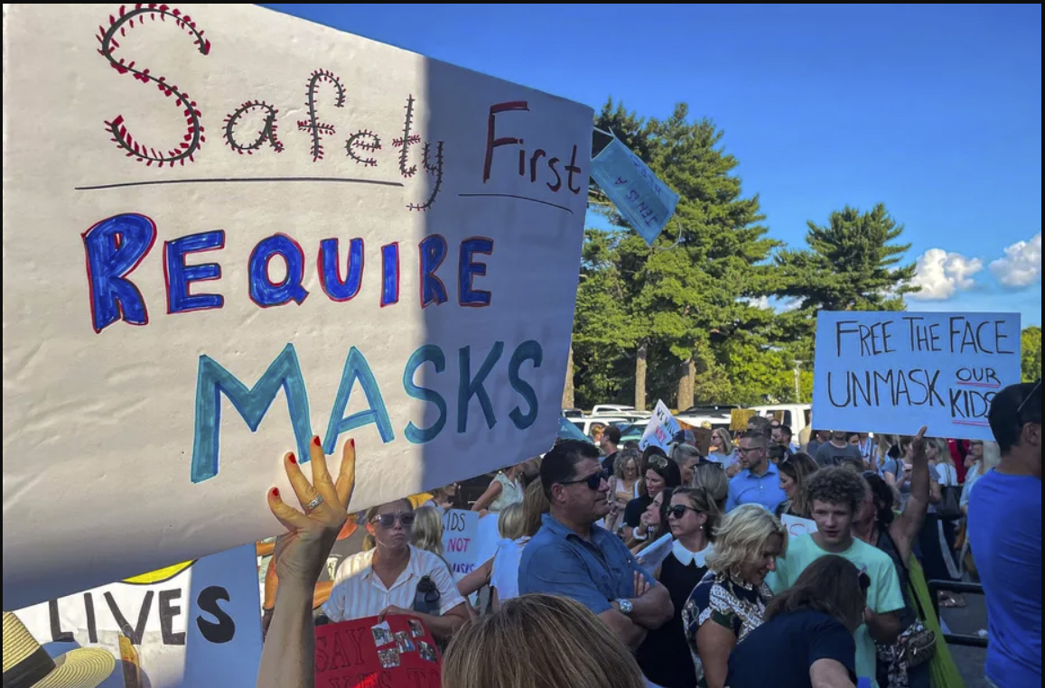Biden is pressuring states to drop bans on mask mandates. Will it work?